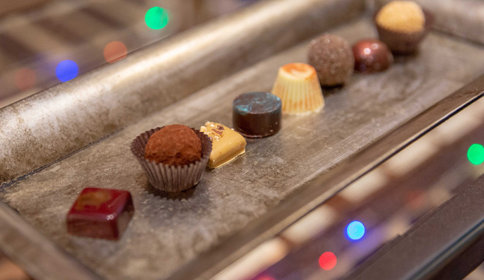 An array of gourmet chocolates on a silver tray
