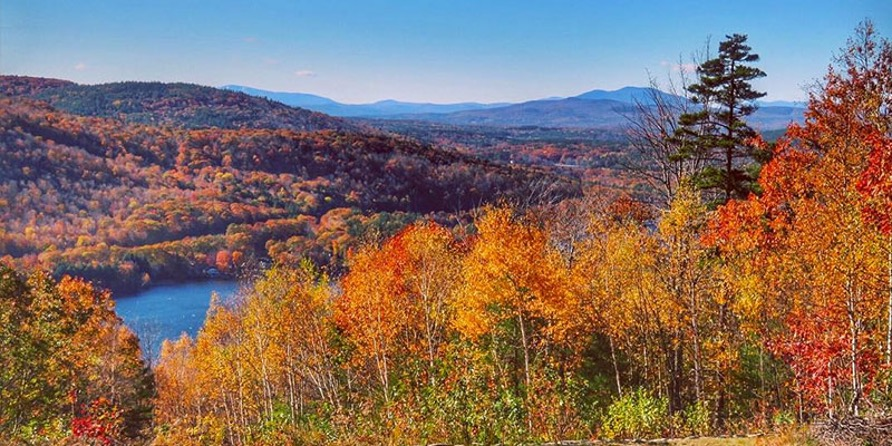 Lake Sunapee Scenic Byway Summit with orange yellow and green foliage