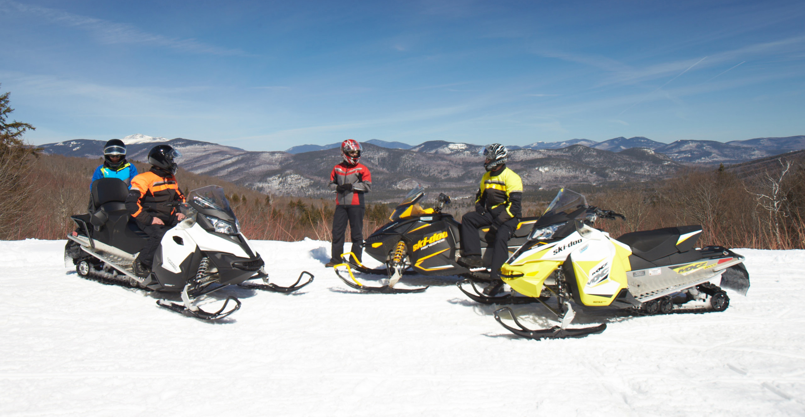 Snowmobilers taking in the views