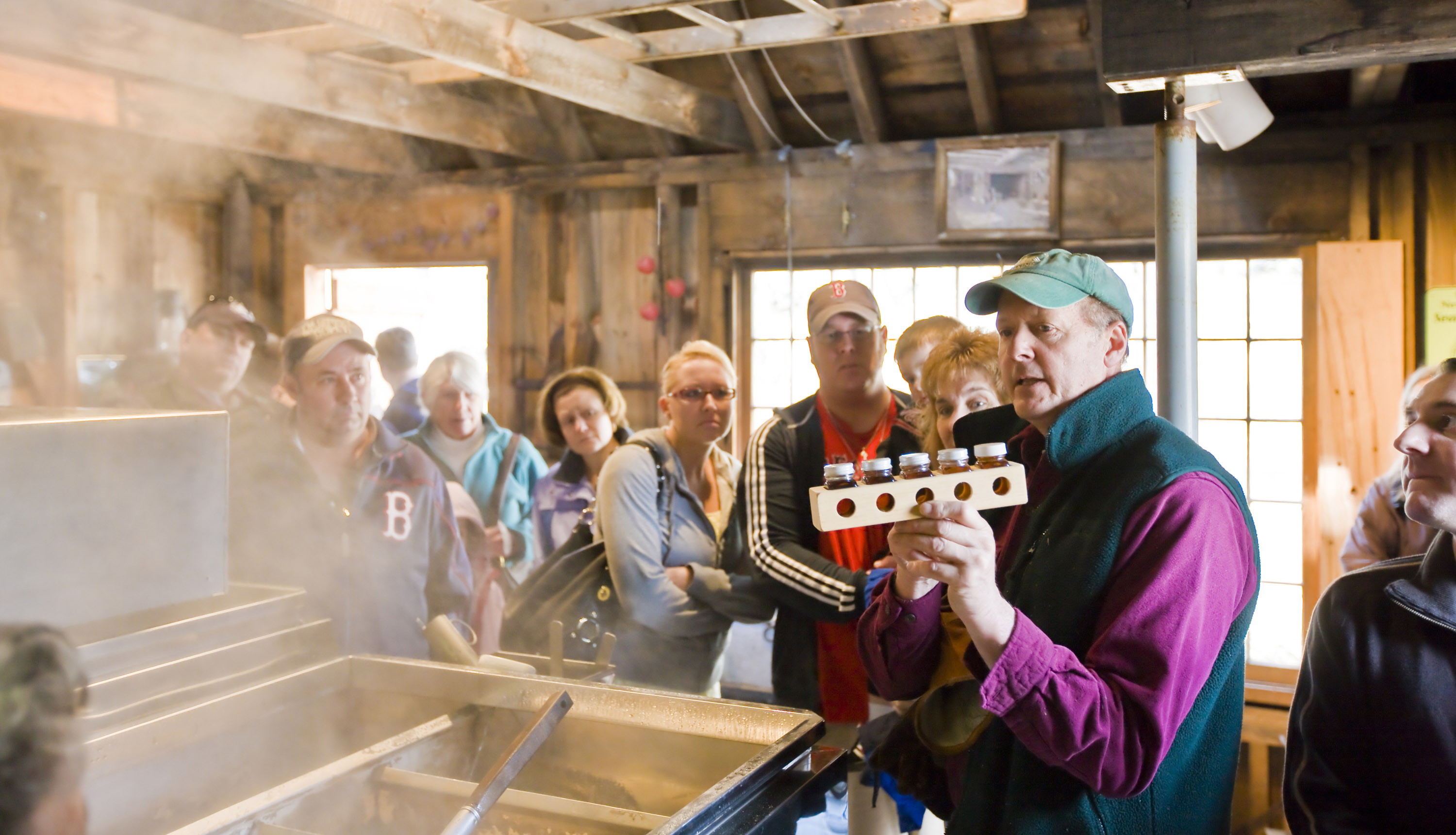 Visitors in a Maple Sugar House