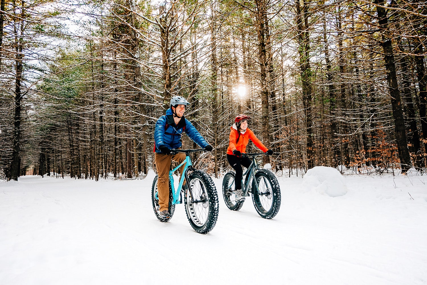 A couple on fat bikes in the snow