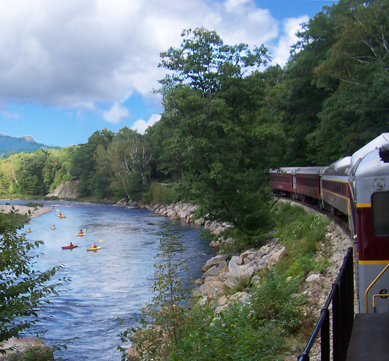 Enjoying our Hobo Picnic lunches while watching kayakers make their way down the lazy Pemigewasset River from the comfort of the Hobo Railroad... All Aboard!